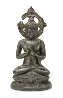 A bronze figure of a Teaching