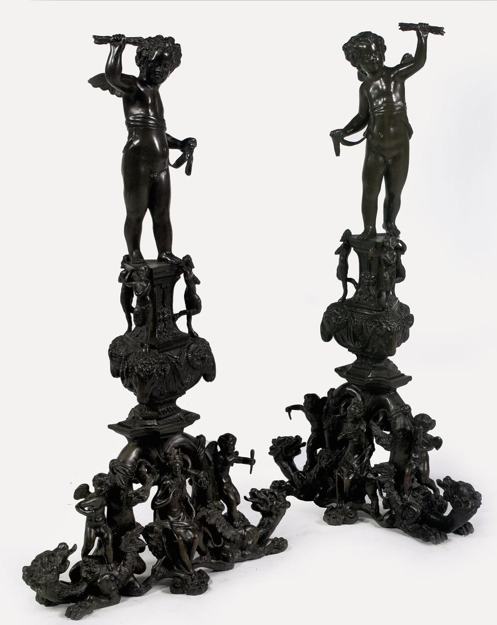 A PAIR OF BRONZE ANDIRONS