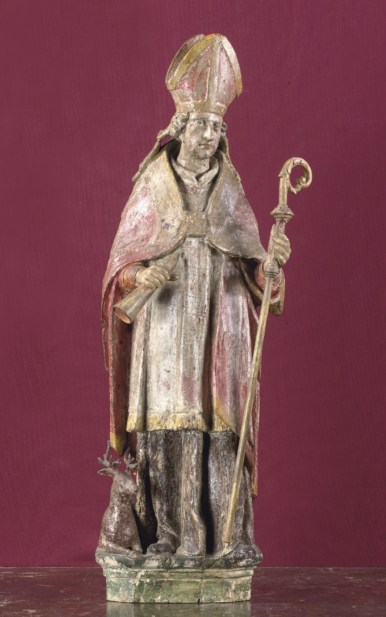 A POLYCHROME CARVED LIMEWOOD FIGURE OF ST HUBERTUS