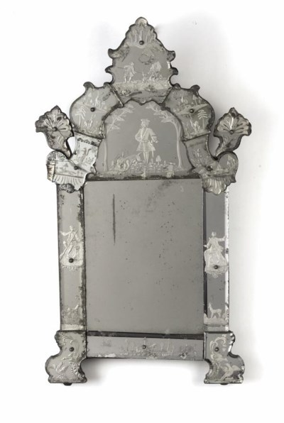 A GERMAN ETCHED MIRROR