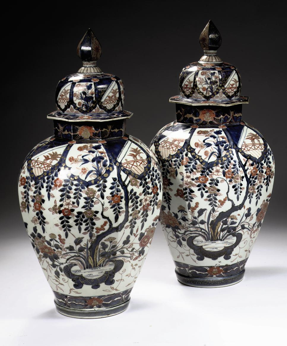 A pair of large Samson Imari octagonal baluster jars and covers