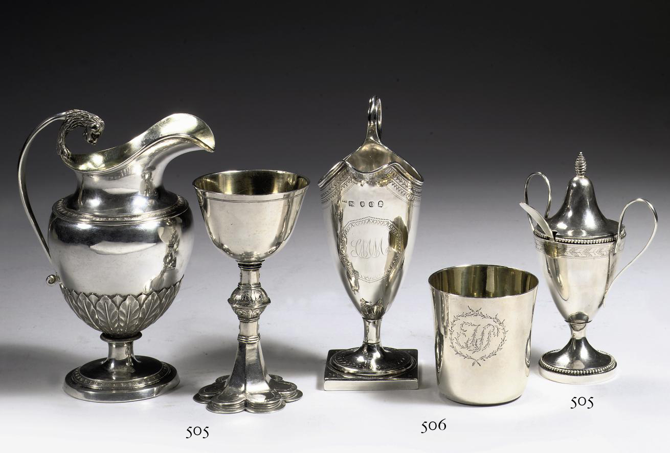An English George II silver helmet-shaped cream-jug and a silver and silver-gilt beaker