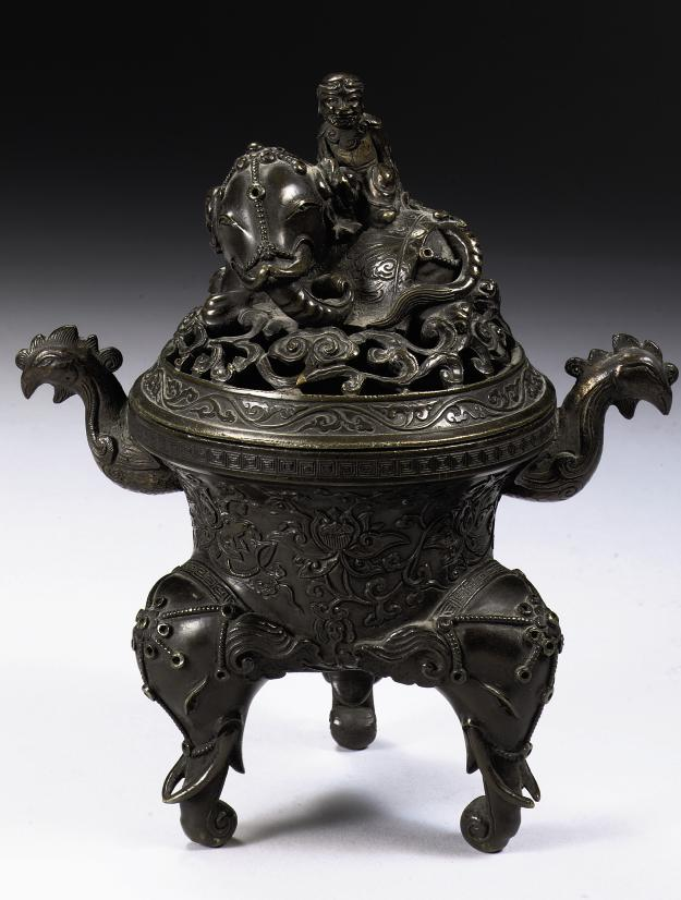 A Chinese bronze censer and cover