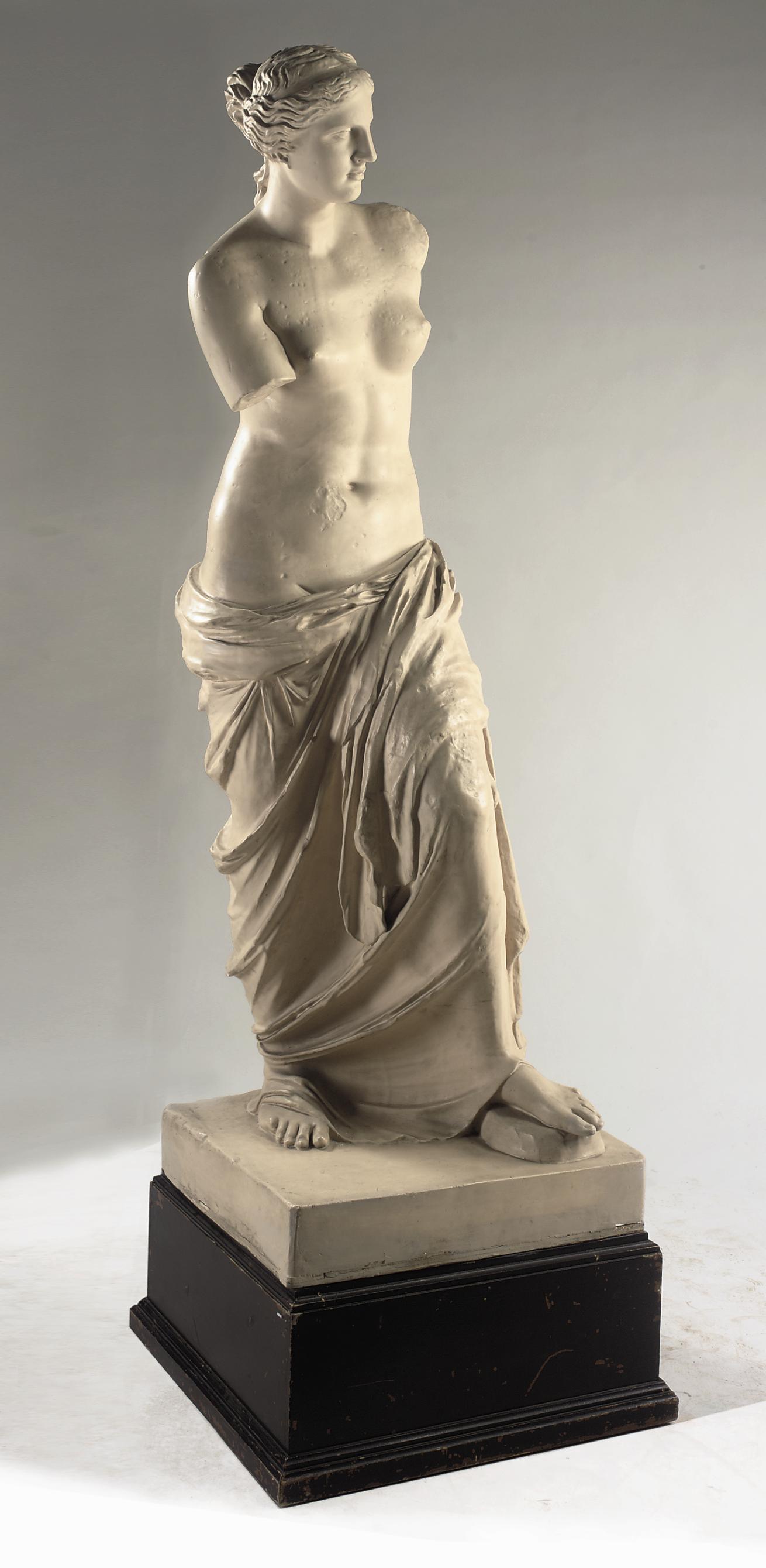 A CREAM PAINTED PLASTER CAST FIGURE OF THE VENUS DE MILO