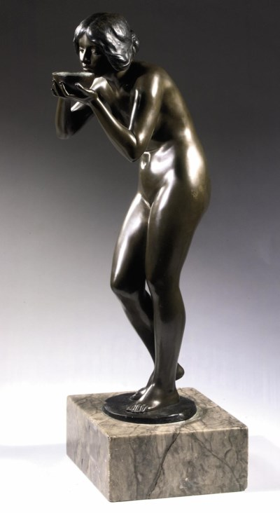 A BRONZE FIGURE OF A DRINKING