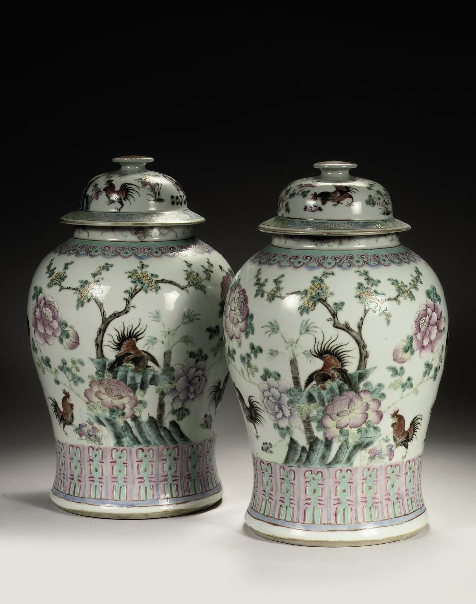 A pair of Chinese famille rose baluster jars and covers