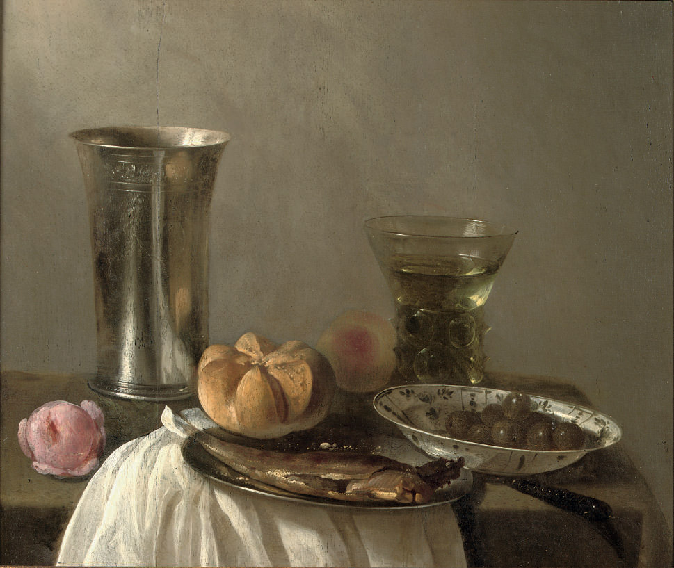 A silver beaker, a herring on a pewter plate, a 'wan-li' bowl with olives and a 'Roemer', all on a partially draped table