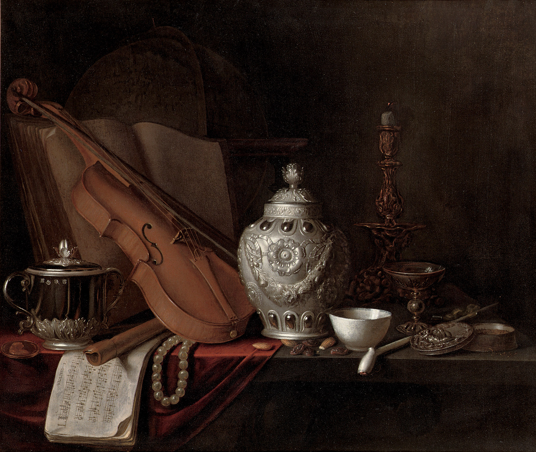 A silver ginger jar, a violin, a silver porringer, a globe, a pearl necklace, a gilt candlestick, a porcelain bowl, a pipe, a silver box, music sheet and almonds, all on a partly draped table