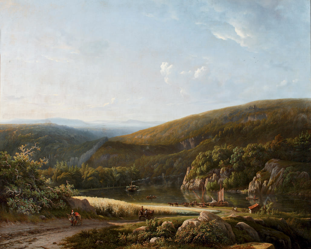 Moored vessels in a panoramic riverlandscape