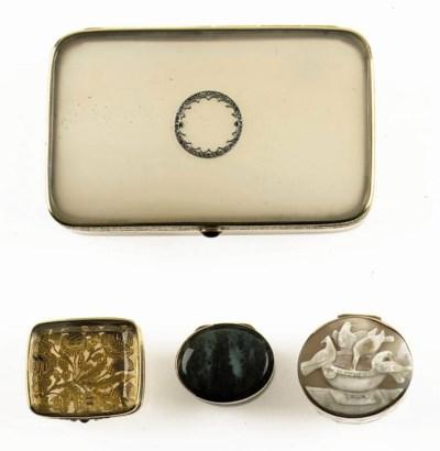 A collection of four gold-moun