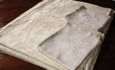 A SET OF TWO DAMASK LINEN TABL