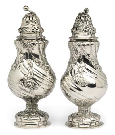 A pair of Dutch silver sugar-c