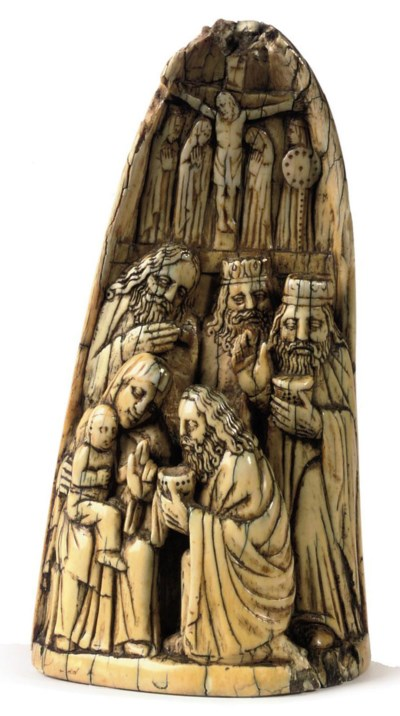 A CARVED IVORY RELIEF OF THE A