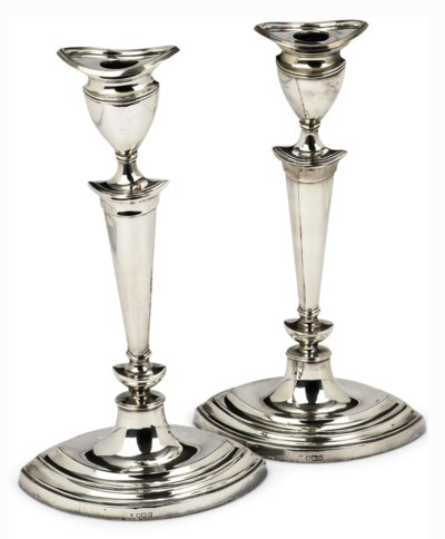 A pair of English silver candl