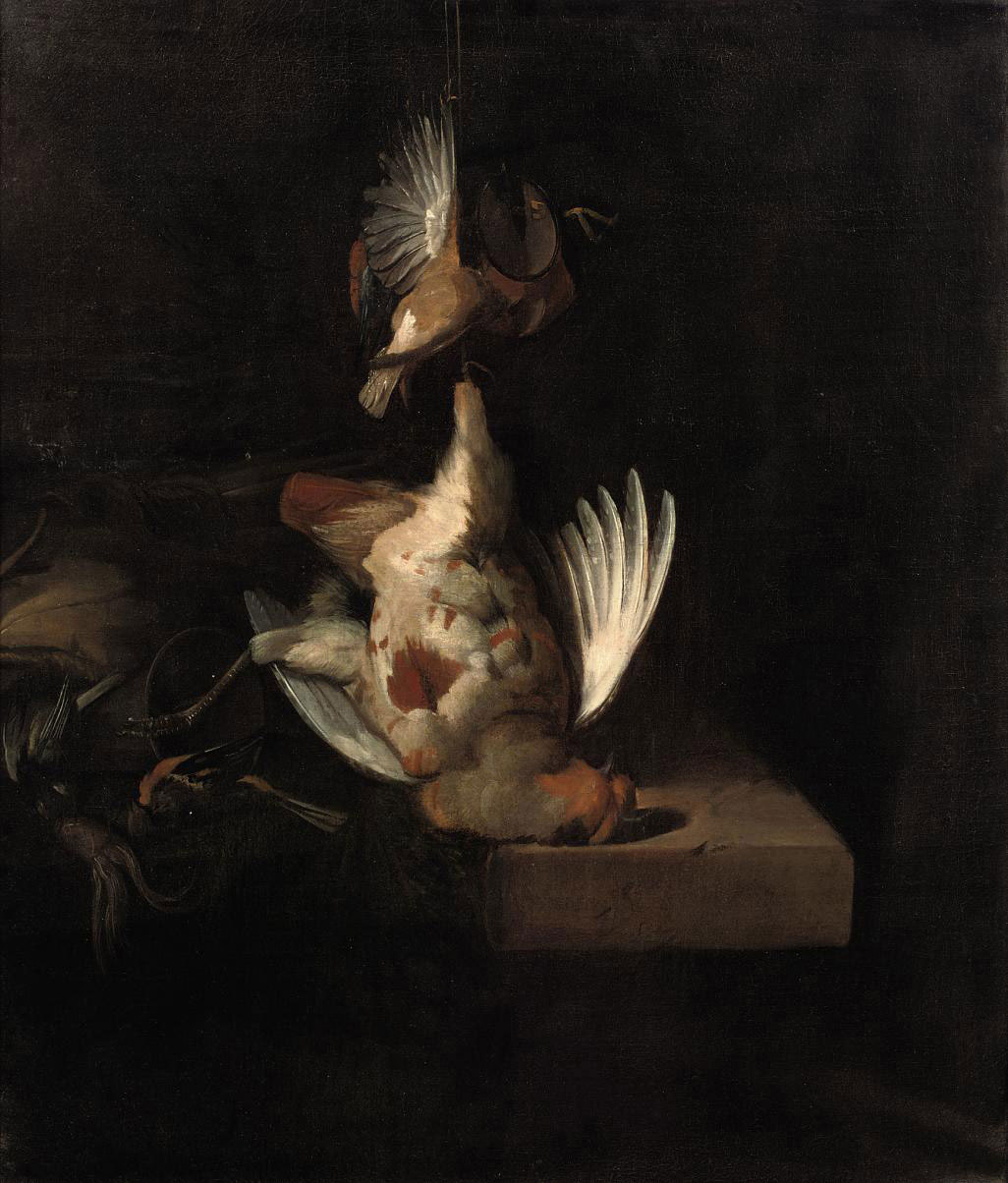 A partridge and other birds hanging above a draped stone ledge along with hunting paraphernalia and small birds