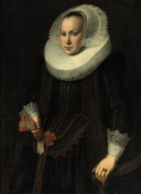 Portrait of a young lady, three-quarter-length, in a gold embroidered black dress with fur lining, a 'molensteenkraag' and a lace headdress and cuffs, standing near a chair holding embroidered gloves