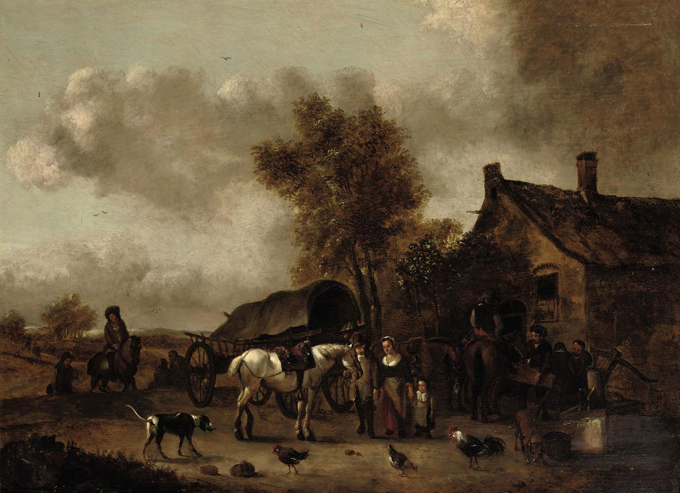 A landscape with horses and riders near a tavern