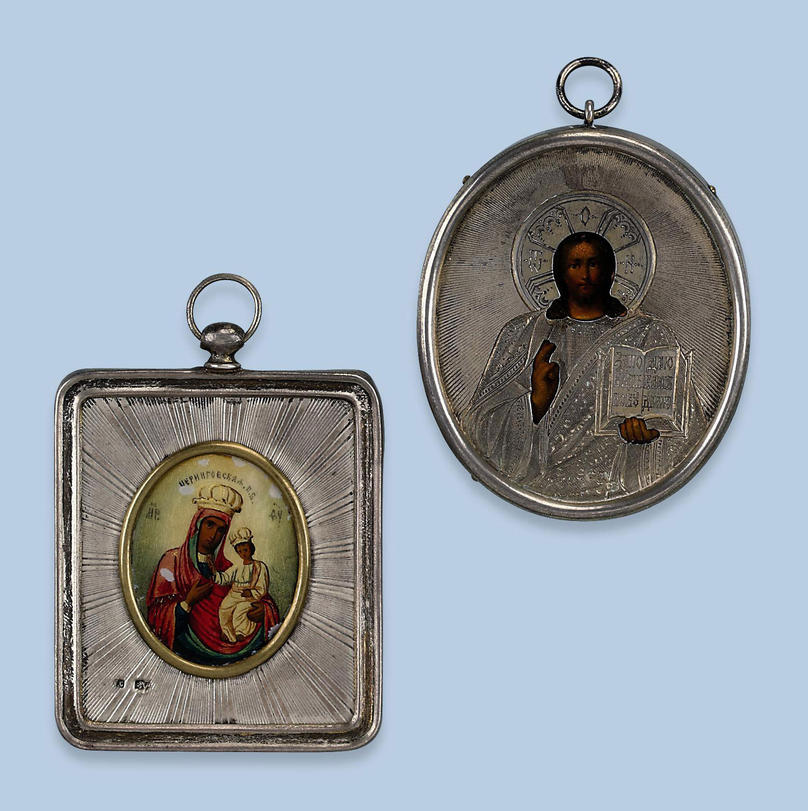 TWO RUSSIAN SILVER ICONIC PEND
