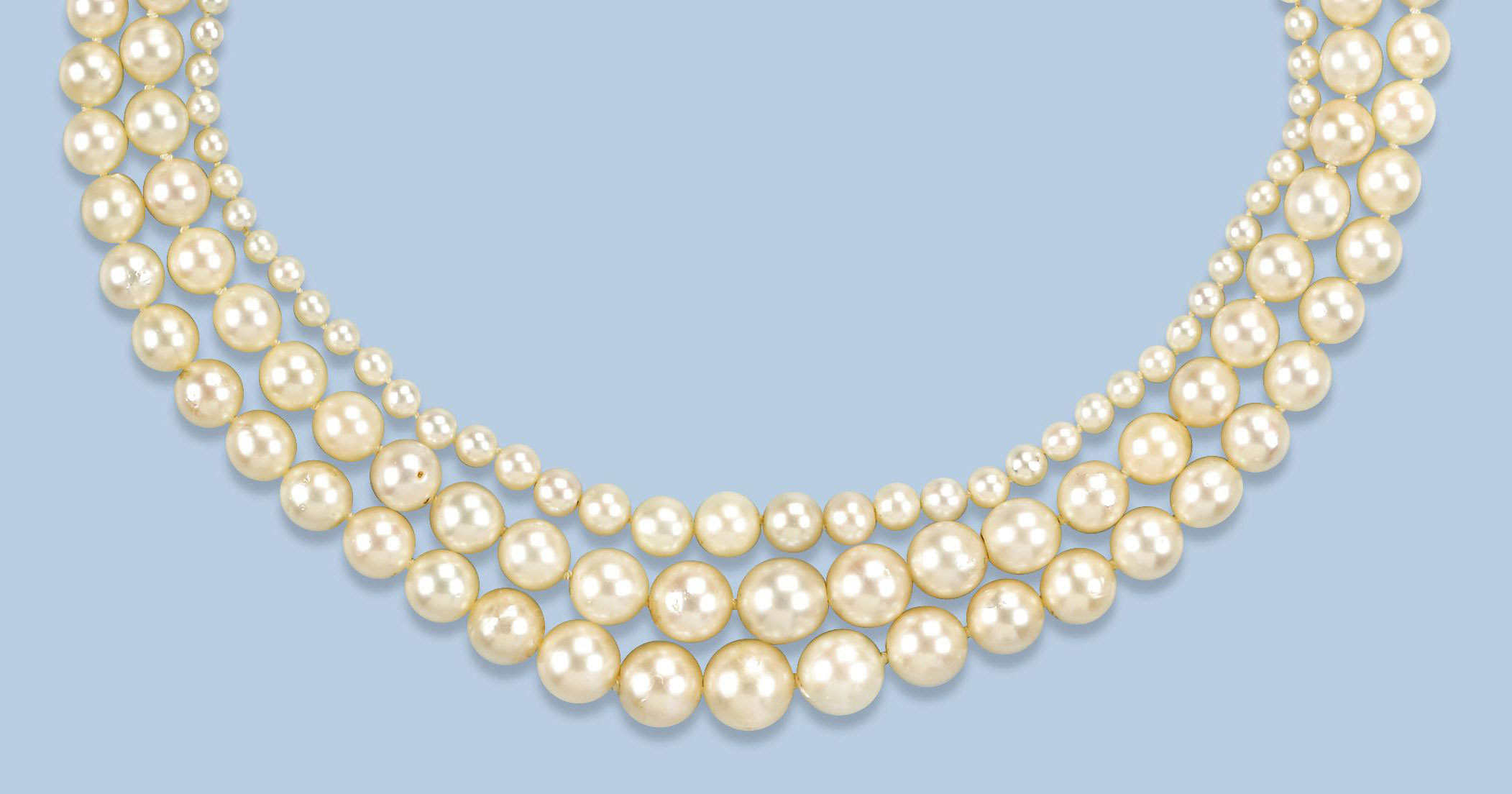 A THREE ROW CULTURED PEARL AND