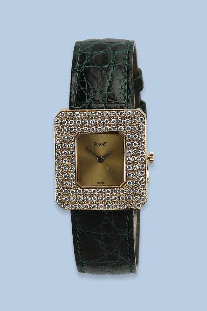 AN 18K GOLD LADY'S DIAMOND WRI