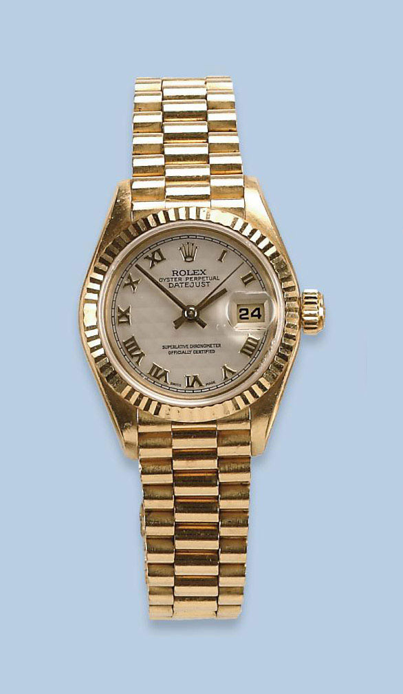 A LADY'S 18K GOLD AUTOMATIC BR