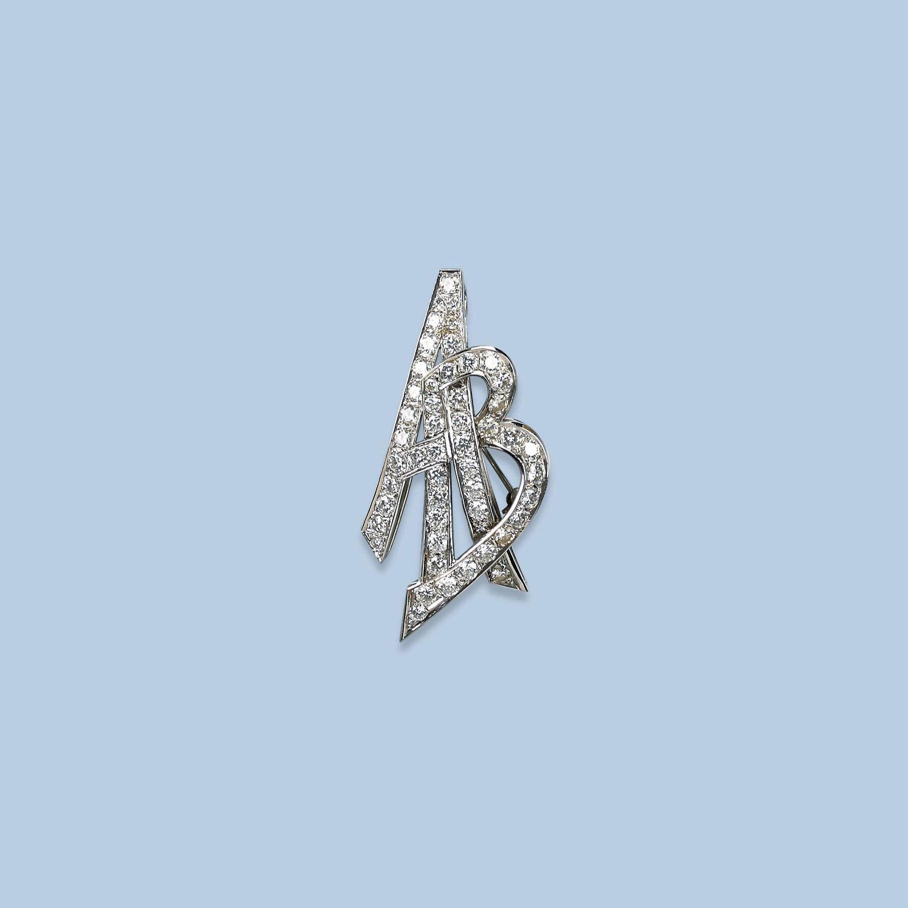 A DIAMOND MONOGRAM BROOCH