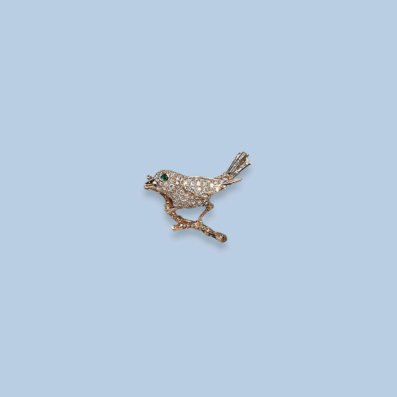 A DIAMOND BIRD BROOCH