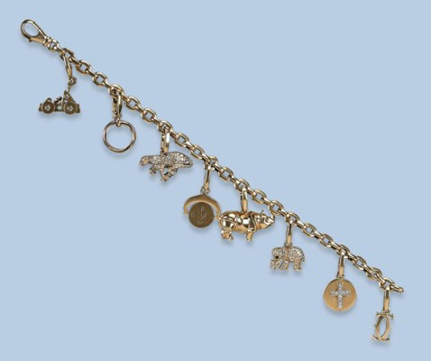 A DIAMOND CHARM BRACELET, BY C