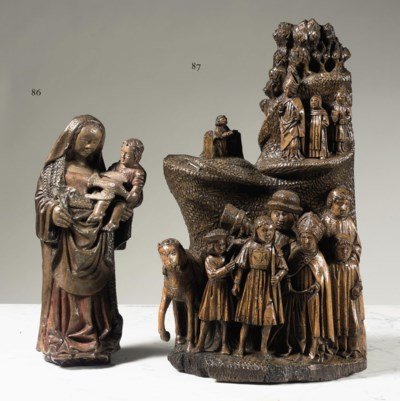 A CARVED WALNUT HIGH RELIEF OF