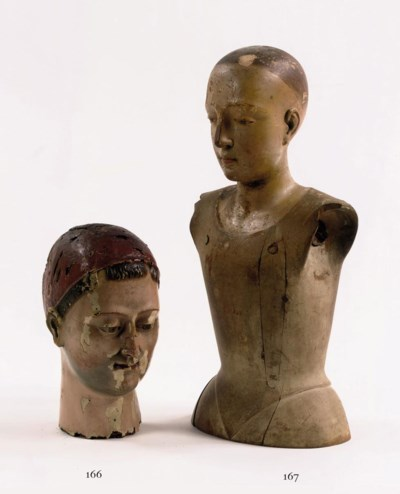 A POLYCHROME CARVED WOOD BUST