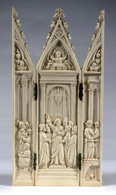 A CARVED IVORY TRYPTICH