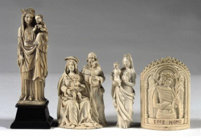 A CARVED IVORY RELIEF OF THE H