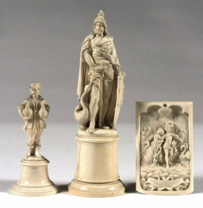A CARVED IVORY FIGURE OF LOHEN