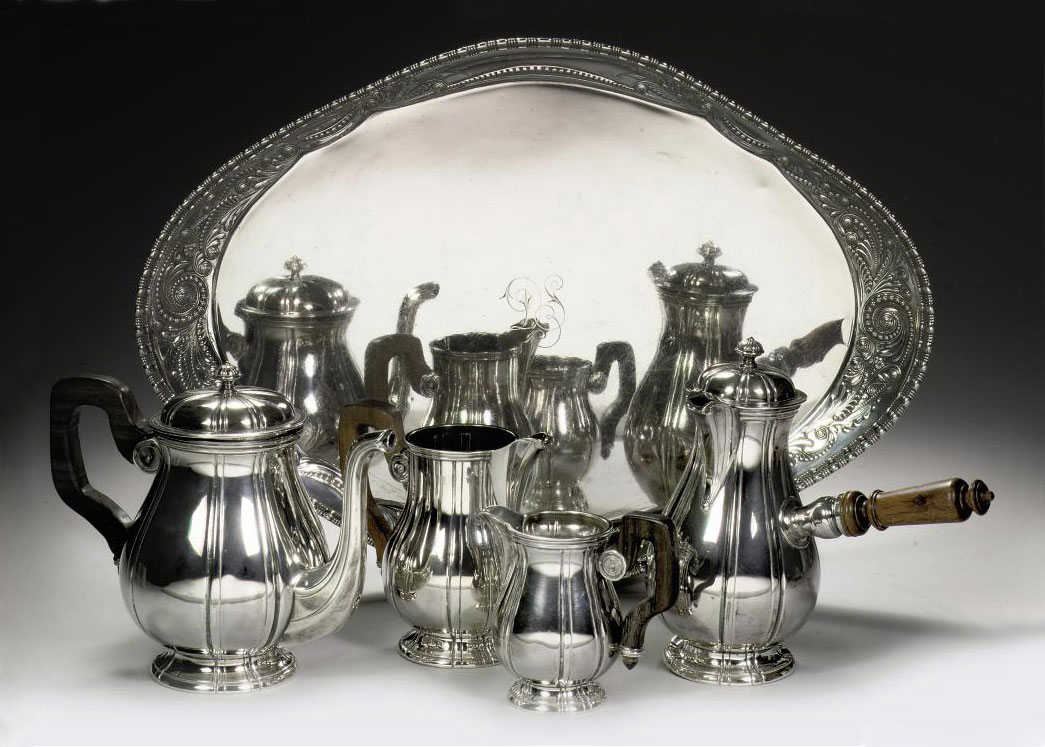 A French silver four-piece tea-service and an American silver tray