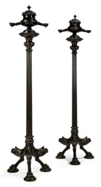 A PAIR OF LATE REGENCY BRONZE COLZA-OIL TOCHERES