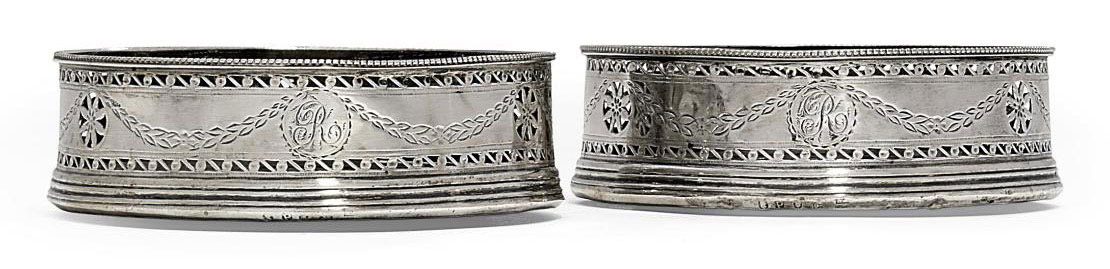 A PAIR OF GEORGE III SILVER WINE-COASTERS