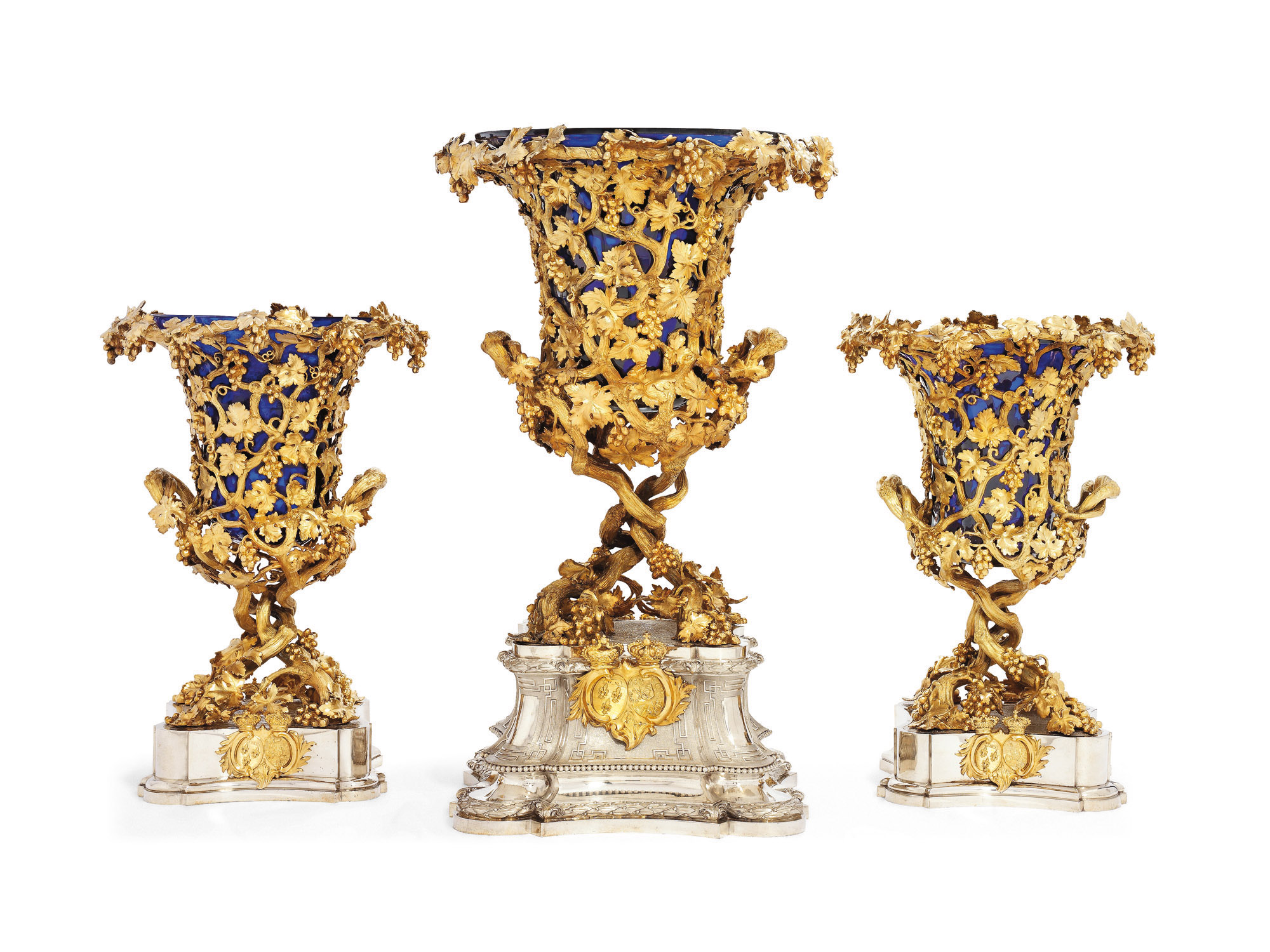 A SET OF THREE VICTORIAN SILVER AND SILVER-GILT VASES