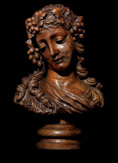 A CARVED WOOD BUST OF A BACCHA