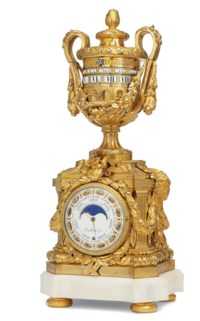 A LOUIS XVI ORMOLU STRIKING AND ASTRONOMICAL VASE CLOCK WITH REVOLVING CHAPTER RINGS ('PENDULE A CERCLES TOURNANTS')