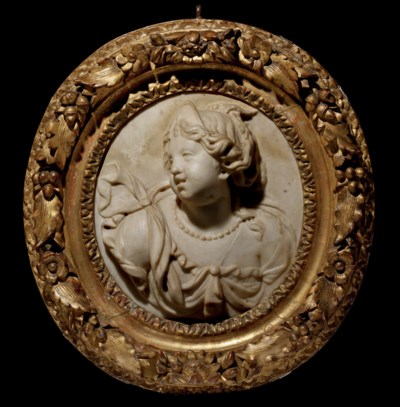 AN OVAL CARVED MARBLE RELIEF O