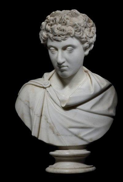 A CARVED MARBLE BUST OF THE YO