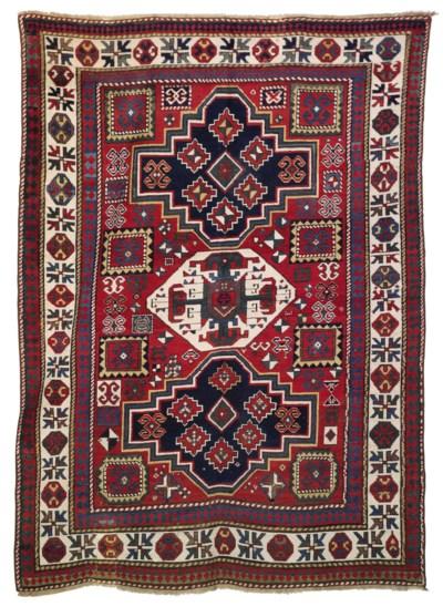 A TRIPLE MEDALLION KAZAK RUG