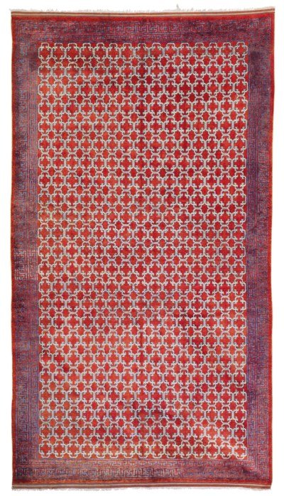 A SILK KHOTAN CARPET
