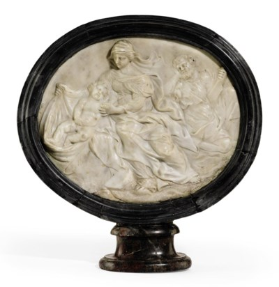 A CARVED OVAL MARBLE RELIEF OF