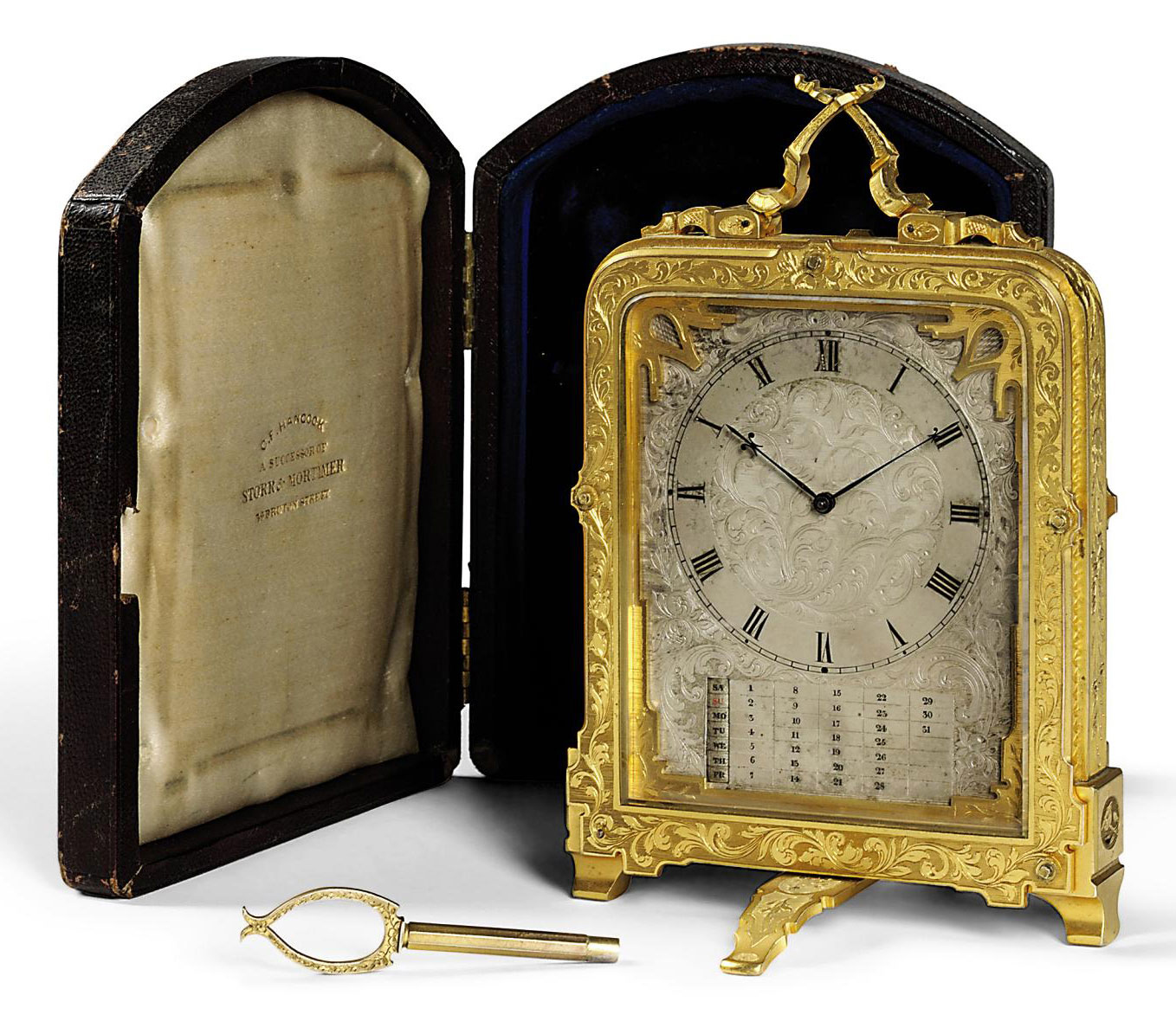 A VICTORIAN ENGRAVED GILT-BRASS EIGHT DAY TIMEPIECE STRUT CLOCK WITH MANUAL MONTHLY CALENDAR