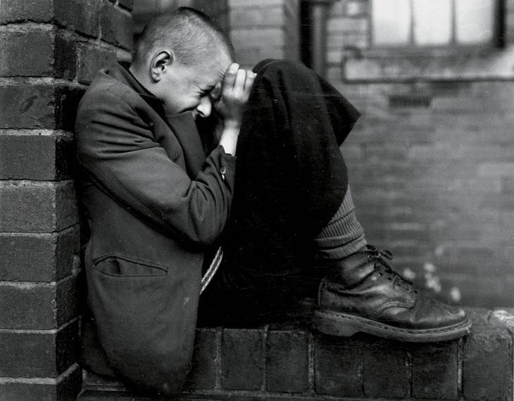 Youth on wall, Tyneside, 1976
