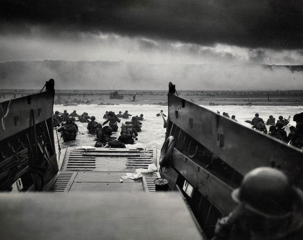 American soldiers wade from Coast Guard landing barge toward the beach at Normandy on D-Day, June 6, 1944