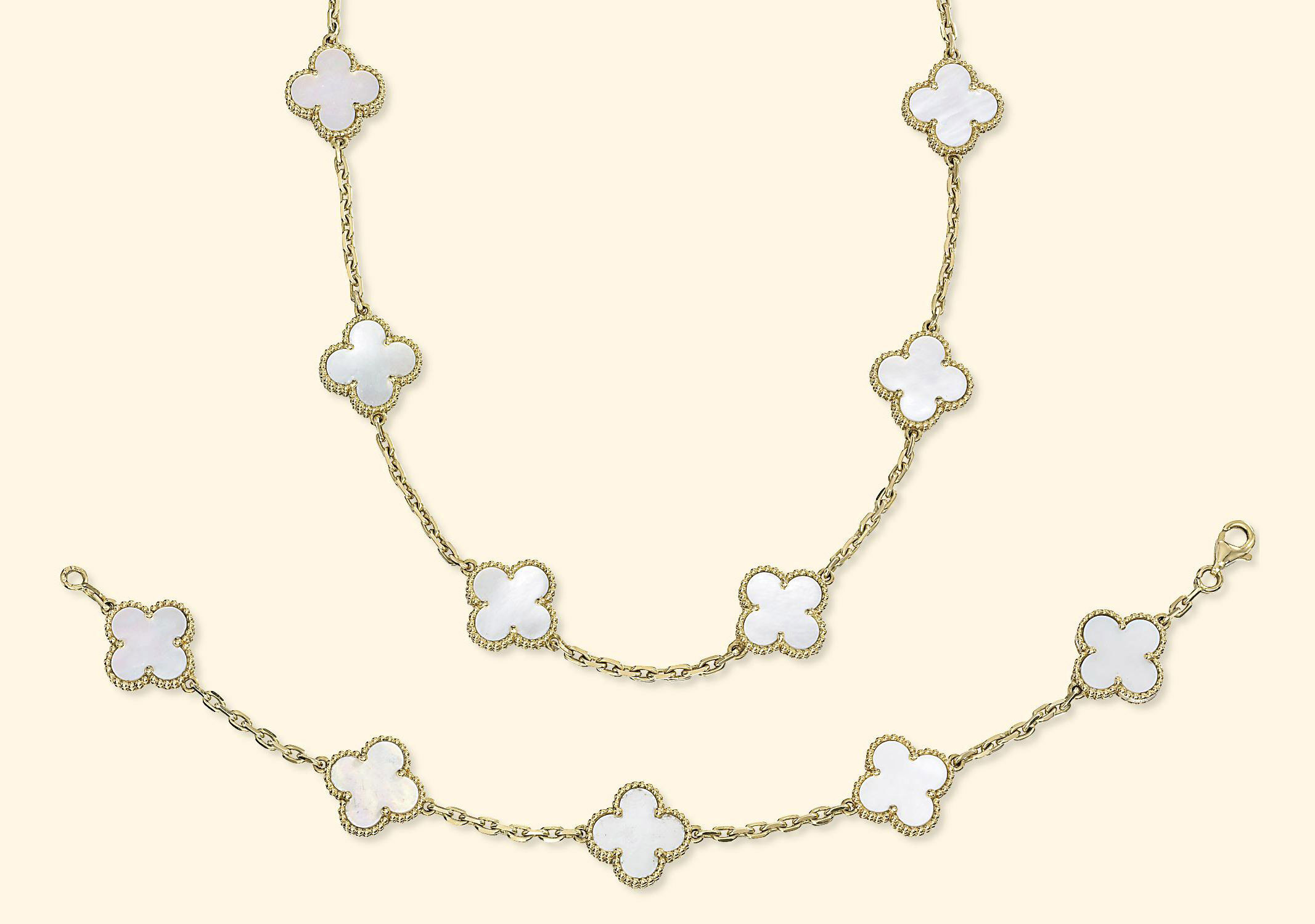 A SET OF GOLD AND MOTHER-OF-PEARL 'ALHAMBRA' JEWELLERY, BY VAN CLEEF & ARPELS