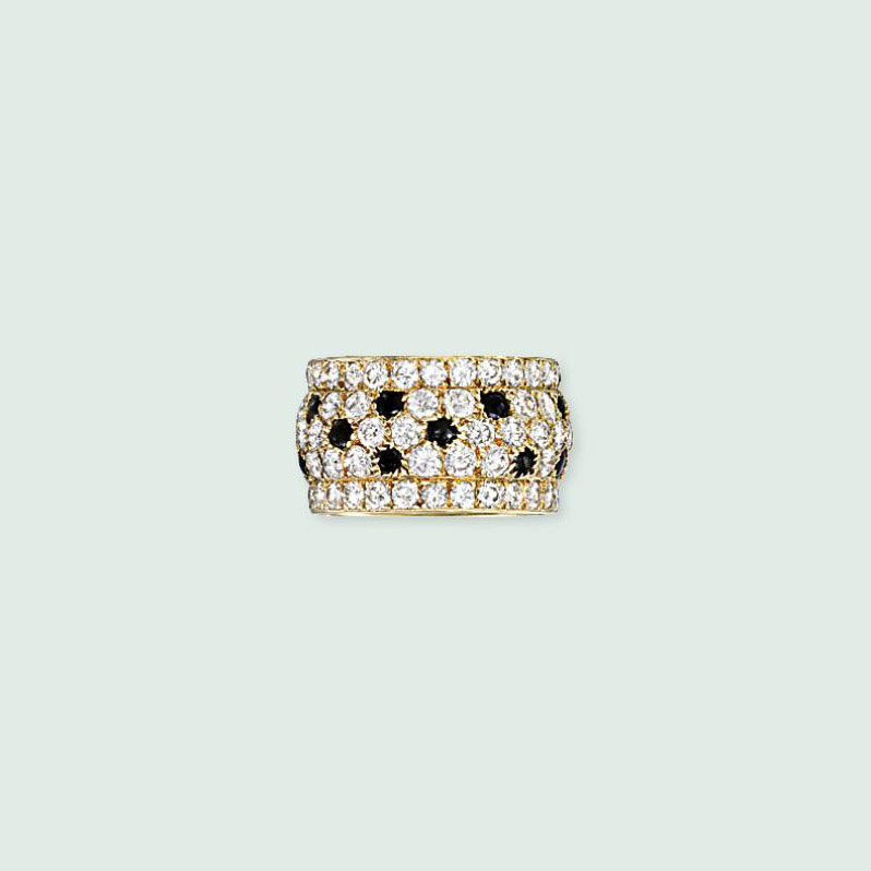 A DIAMOND AND ONYX 'PANTHER' RING, BY CARTIER