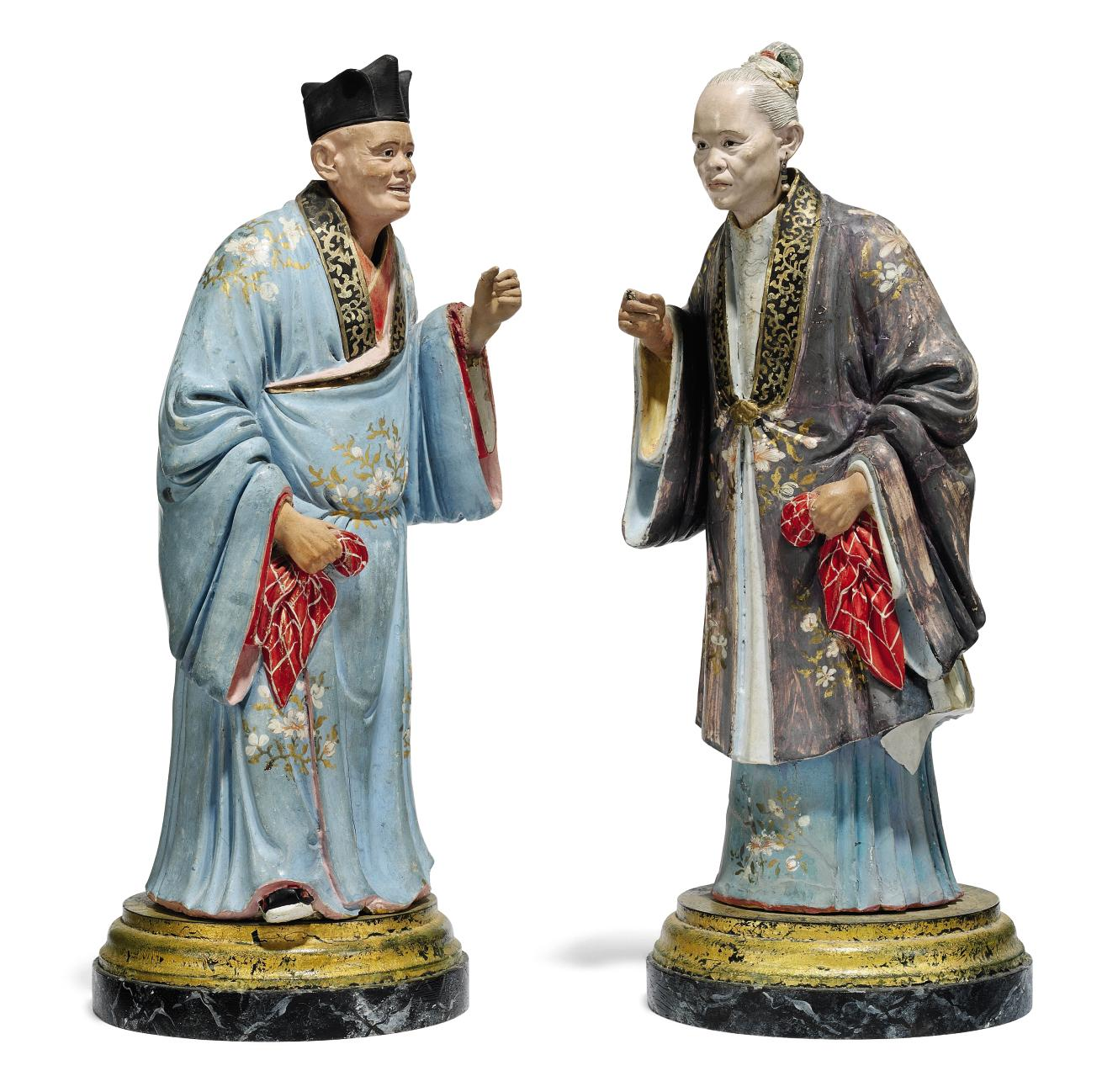 A PAIR OF PAINTED-PLASTER NODDING-HEAD FIGURES